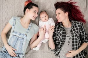 Two-young-women-a-lesbian-homosexual-couple-ADOPTION-300x200