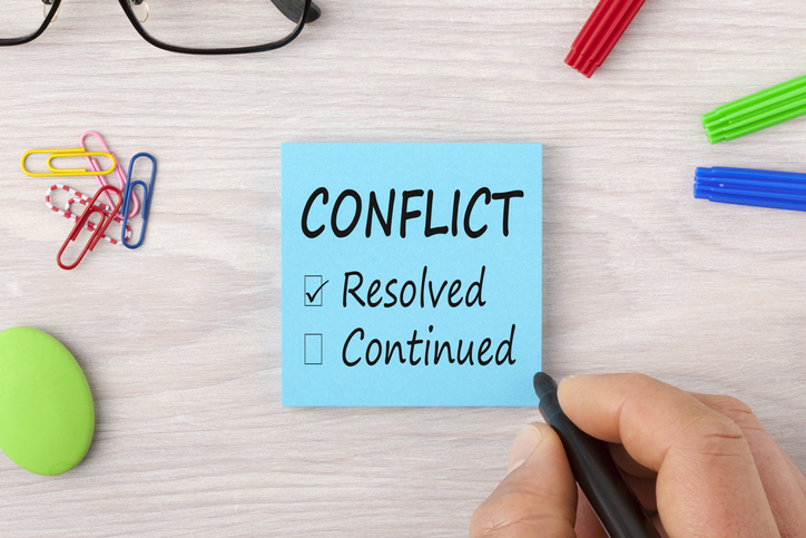 Conflict-writing-on-note-concept-929629754_727x484
