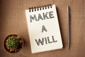 Word-text-Make-a-will-on-white-paper-on-office-table-business-concept-978808346_727x484-300x200