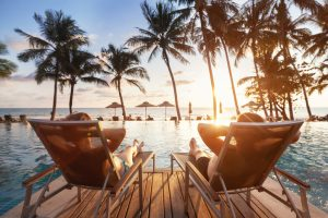 luxury-travel-romantic-couple-in-beach-hotel-1213840216_727x484-300x200